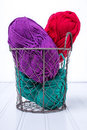Coloful yarn in wire basket a full of colorful skeins Stock Photography