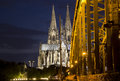 Cologne bridge and cathedral part of the hohenzollern railway in germany illuminated at night Stock Image
