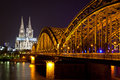 Cologne cathedral and bridge over the rhine river germany riverside night view of railway Stock Photography