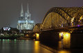 Cologne Cathedral and Hohenzollern Bridge at night Royalty Free Stock Image