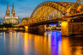 Cologne Cathedral and Hohenzollern Bridge at night, Germany Royalty Free Stock Photo