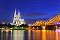 Cologne cathedral and hohenzollern bridge night view of germany Royalty Free Stock Images