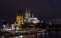 Cologne cathedral at night koln overlooking the rhine river in germany Royalty Free Stock Photo