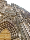 Cologne cathedral view upward toward sky of tower and door archway in german historic city Stock Photography