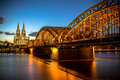 Cologne germany bridge over rhine river with cathedral in the background at night Stock Image