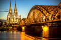 Cologne germany bridge over rhine river with cathedral in the background at night Royalty Free Stock Image