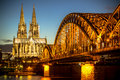 Cologne germany bridge over rhine river with cathedral in the background at night Royalty Free Stock Images