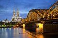 Cologne germany image of with cathedral and hohenzollern bridge across the rhine river Royalty Free Stock Photo