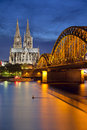 Cologne germany image of with cathedral and hohenzollern bridge across the rhine river Royalty Free Stock Image