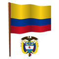 Colombia wavy flag and coat of arms against white background vector art illustration image contains transparency Stock Photo