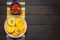 Colombian arepa with hogao sauce arepas on plate tomato and onion cooked in bowl arepas are made of yellow or white corn meal and Stock Photos