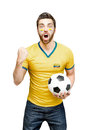 Colombian fan holding a soccer ball celebrates on white background Royalty Free Stock Photo