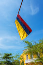 Colombian flag and blue sky in the old town of cartagena colombia with colonial architecture Royalty Free Stock Images