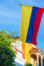 Colombian flag view of the with colonial architecture and blue sky in cartagena colombia Stock Image