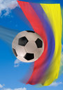 Colombian soccer ball flying fast with flag in background Royalty Free Stock Photo