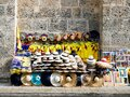 Colombian soccer team shirts for sale on a street of old cartagena colombia with colorful hats and copies of Botero paintings Royalty Free Stock Photo