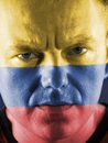 Colombian supporter closeup of young face painted with national flag colors Stock Photo