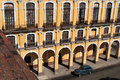 Colonial architecture in a place of havana old american car and city center from the top near building Royalty Free Stock Photo