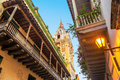 Colonial balconies and church view looking up at historic a in cartagena colombia Royalty Free Stock Photo