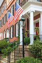 Colonial brick architecture with american flags red Stock Photo