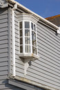 Colonial georgian cottage window feature photo of a vintage bay on weather boarded kent Royalty Free Stock Photo