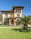 Colonial house in cangas with a palm tree on one side located the spanish town of de onis asturias northern spain it s a Royalty Free Stock Images