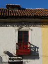 Colonial window and balcony. Royalty Free Stock Photo
