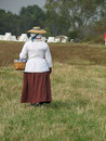 Colonial Woman with Basket Stock Image