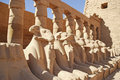 Colonnade and flock of sheep statues between the first and second pilon in karnak temple luxor egypt Stock Photos