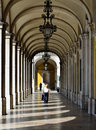 Colonnade of praca do commercio lisbon stark sunlight creates a striped walkway in one the colonnades surrounding Stock Photography