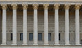 A colonnade of a public law court. A neoclassical building with a row of corinthian columns. Royalty Free Stock Photo