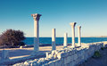 Colonnade in ruins of the Ancient Greek city of Chersonese Royalty Free Stock Photo
