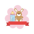 Color background with ribbon and bunny toy with baby bottle