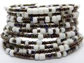 Color bead bracelet close-up, African handmade fashion jewelry Royalty Free Stock Photo