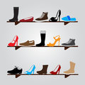 Color boots on shelf eps wood Royalty Free Stock Photography