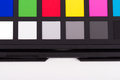 Color checker equipment close up view of of professional photographer for adjust and balance photograph isolated on white Royalty Free Stock Photography