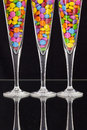 Color chocolate tablets inside the champagne glasses on a black glass plate Stock Photo