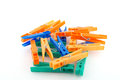 Color clothes pegs over white Royalty Free Stock Photography