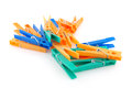Color clothes pegs over white Stock Photography
