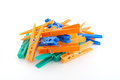 Color clothes pegs over white Stock Images