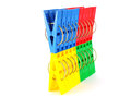 Color clothes pegs over white Royalty Free Stock Images