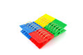 Color clothes pegs over white Stock Photo