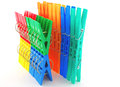 Color clothes pegs over white set multi Stock Images