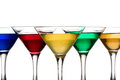 Color cocktails in martini glasses organized v shape Royalty Free Stock Images