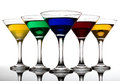 Color cocktails in martini glasses organized v shape Stock Photos