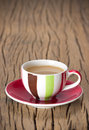 Color coffee cup saucer old wood plank Stock Photography