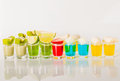 Color drinks in shot glass, blue, green, red, yellow and creamy Royalty Free Stock Photo