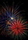 Color explosions fireworks fill the night sky with vivid bursts of Stock Image