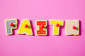 Color of faith wooden text in word on pink background Royalty Free Stock Photo