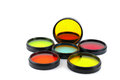 Color filters for lenses over white Royalty Free Stock Photo